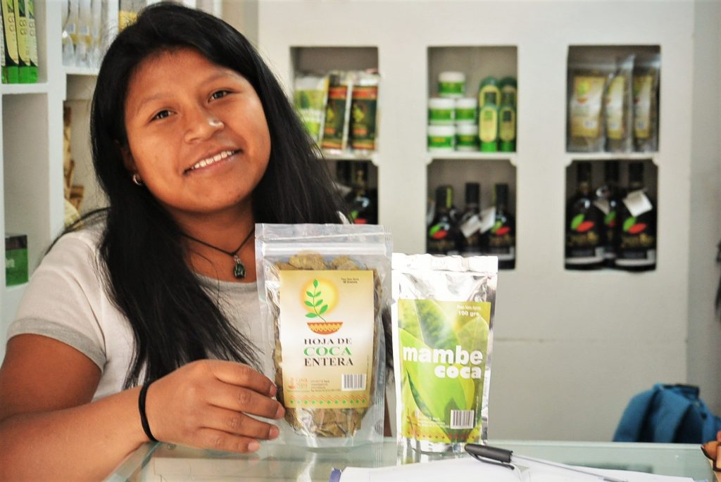 Sandra Quilcue in her shop with coca leaves and mambe (powdered coca)