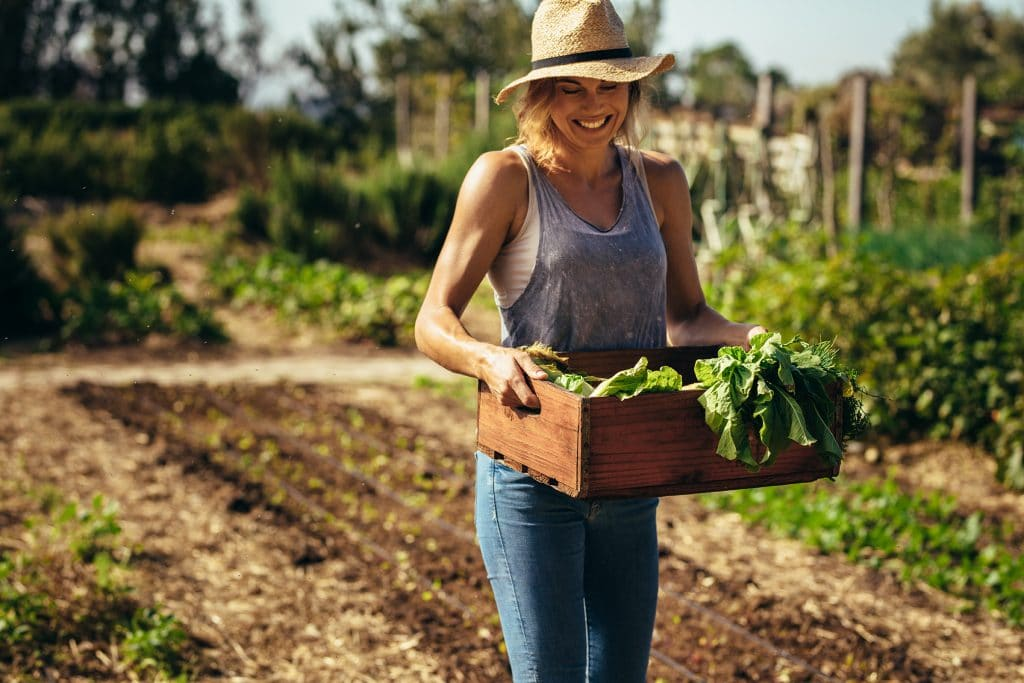 A happy and healthy woman gardening