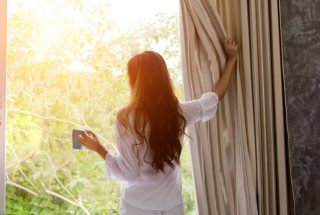 A girl admiring in the sunrise