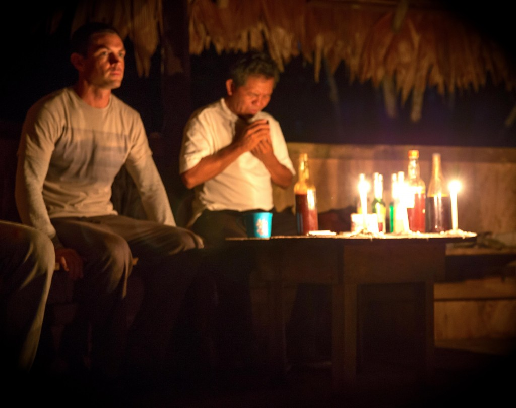 A man waits for the shaman to bless the ayahausca during a ceremony near Iquitos, Peru.