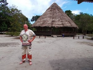 Crittenden wearing traditional Shipibo clothing outside the maloka at Nihue Rao.