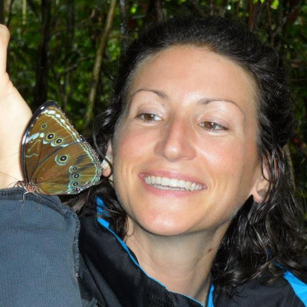 Sara with a butterfly: a symbol of metamorphosis.