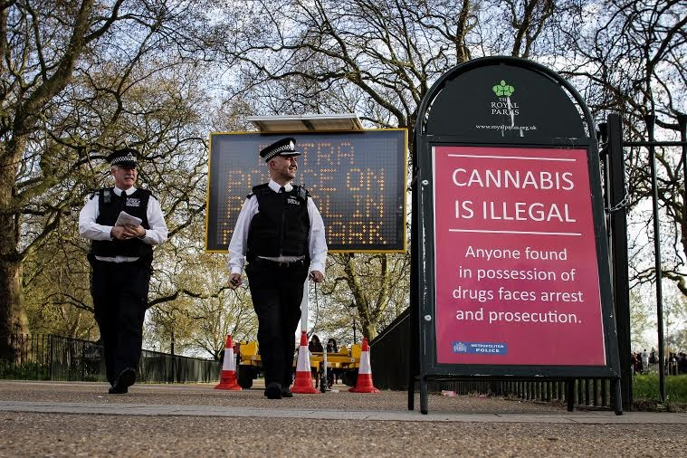 Signs outside of Hyde Park's 4/20 event. Photo by Jamie White.