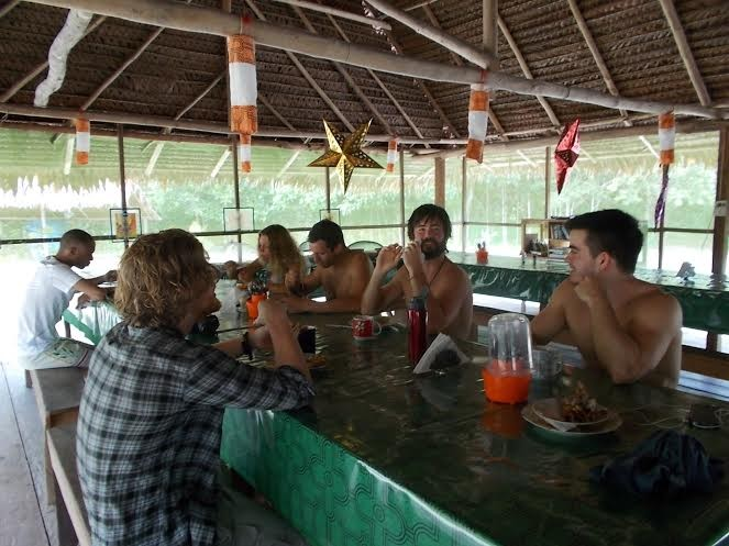 Photo: Lunch in the dining hall at the Nihue Rao Spiritual Center near Iquitos, Peru. Author Michael Sanders is second from the right in photo. By Guy Crittenden.