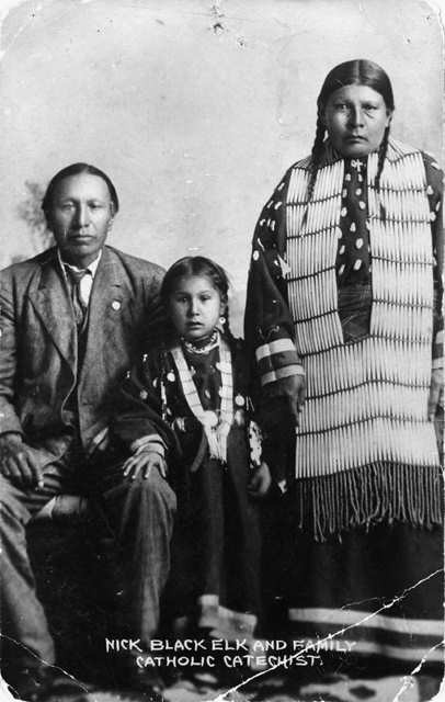 Photo: Nicholas Black Elk, daughter Lucy Black Elk and wife Anna Brings White, photographed in their home in Manderson, South Dakota (1910).