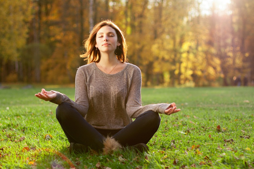 Meditation is a powerful tool to manage mood. Via: Evdokimov Maxim | Shutterstock.