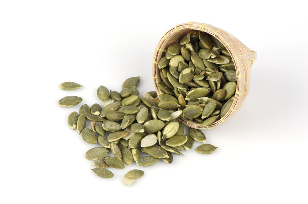 A half cup of pumpkin seeds provides nearly 100 percent of the daily requirement for magnesium. Via: wasanajai | Shutterstock.