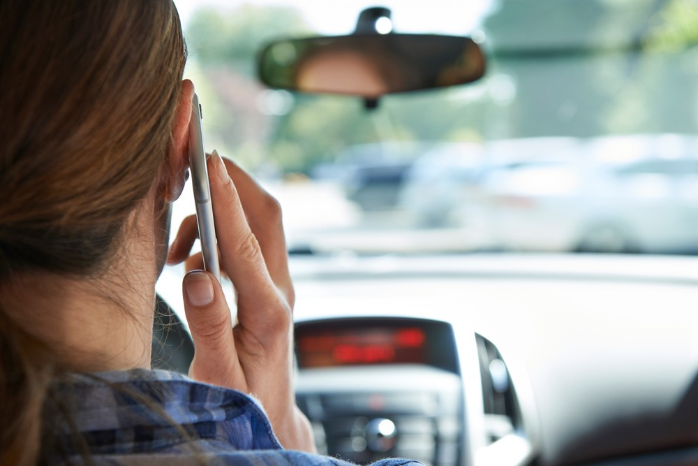 The increase in accidents among cell phone users may be caused by the flood of calcium ions into brain cells. Via: SpeedKingz   Shutterstock.