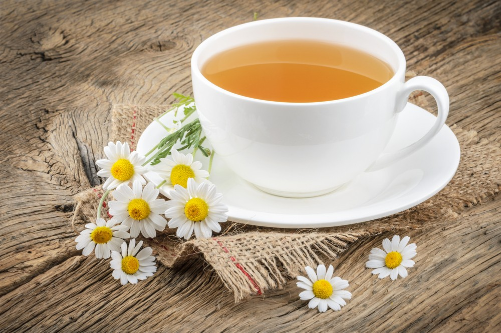 Chamomile tea can help soothe stomach inflammation and help you sleep. Via: azure1 | Shutterstock.