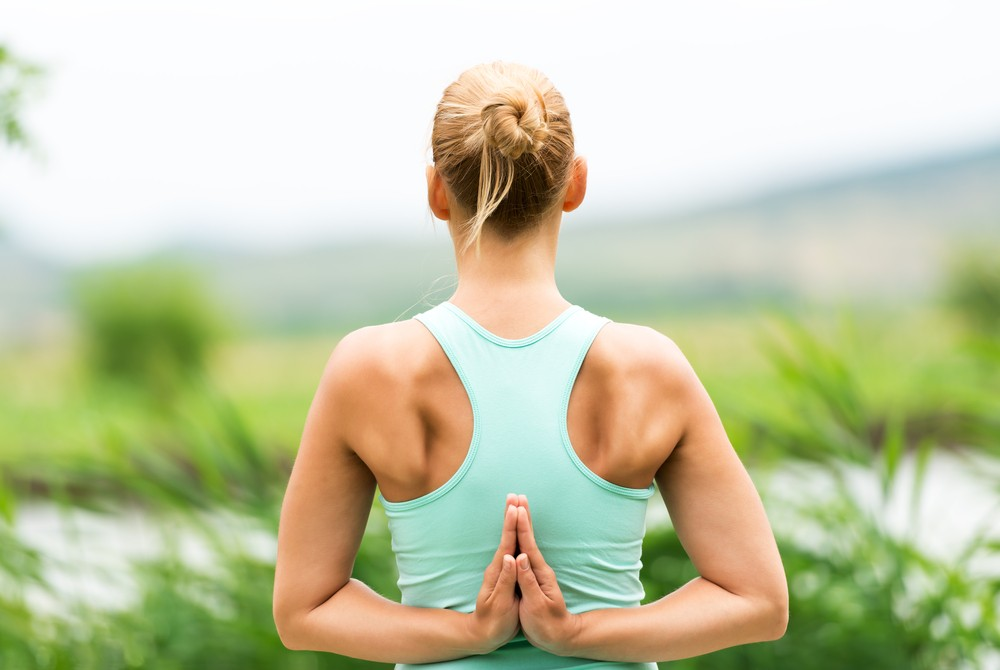 Yoga is a moving meditation that can help you reduce stress and increase concentration. Via: LeventeGyori | Shutterstock.