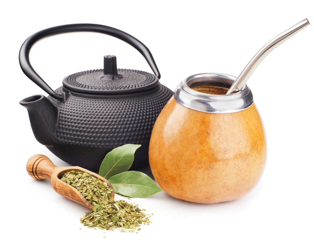 Yerba mate is traditionally served in a gourd and sipped through a bombilla. Via: Andrii Gorulko | Shutterstock.