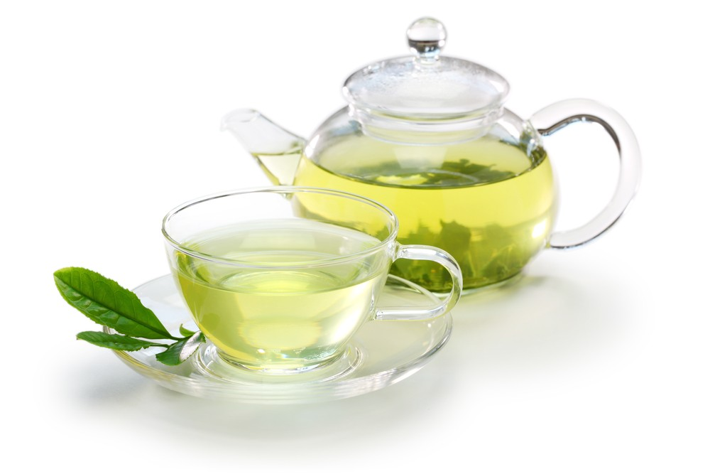 Green tea has less caffeine and contains relaxing compounds that smooth out caffeine's rough edges. Via: bonchan | Shutterstock.