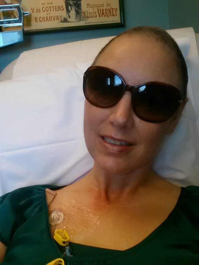 Gritted teeth smile amidst chemo.
