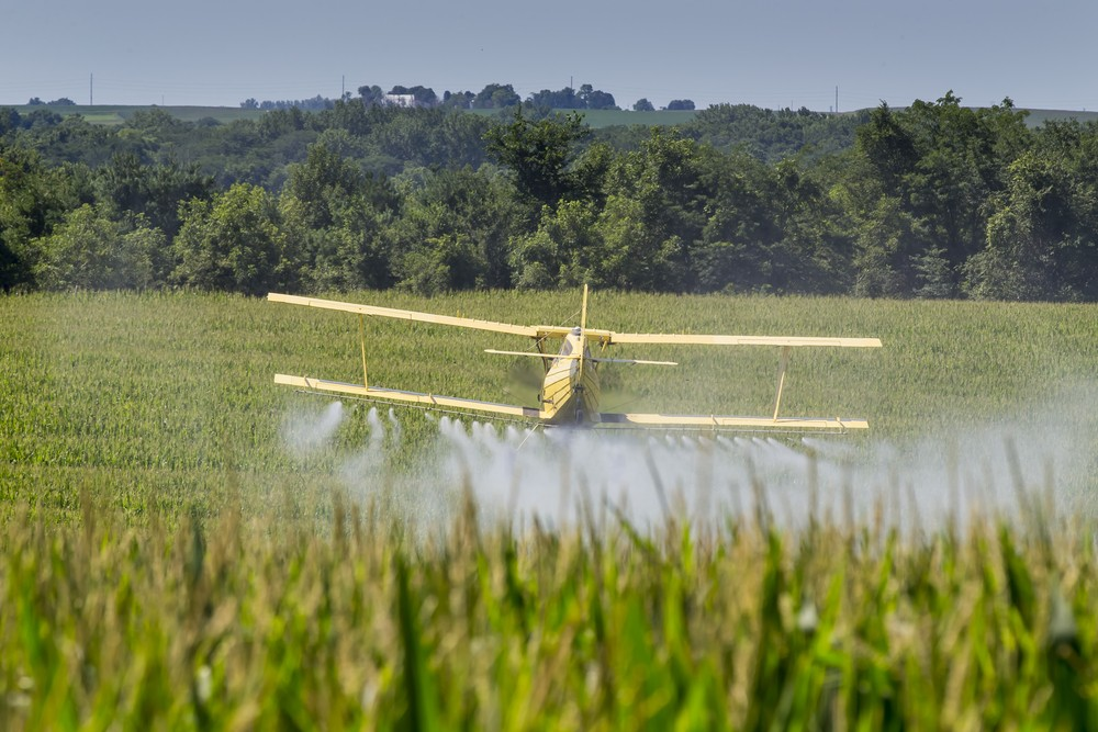 Photo: A crop duster applies chemicals to a field. Via: Action Sports Photography   Shutterstock.