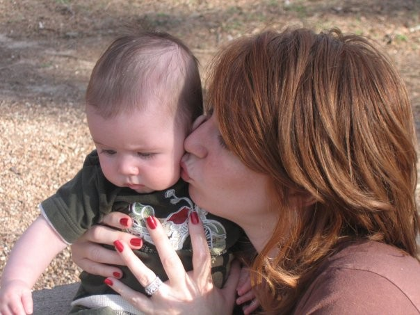 Jennifer Cross with her baby Syd. Cross feels like she was duped into accepting intervention during her first birth that she did not want or need. Photo via: Jennifer Cross